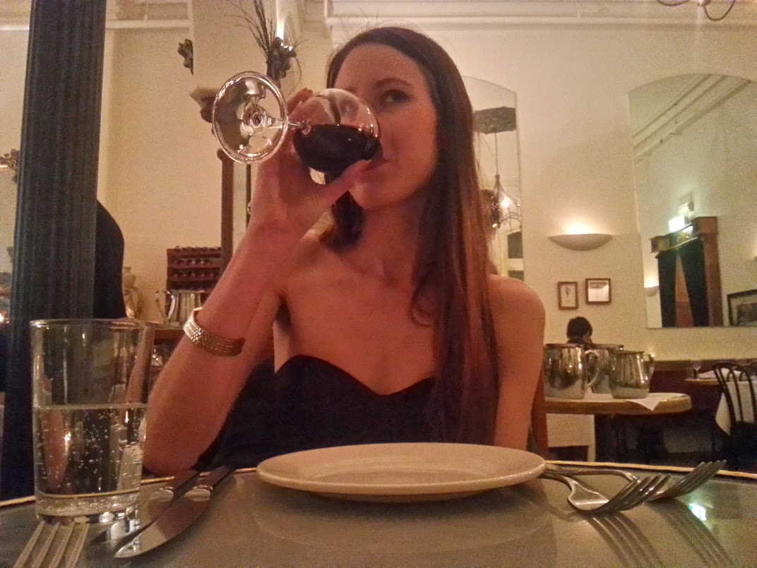 In my natural habitat, eating and drinking wine.